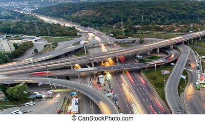 Traffic on freeway interchange. Aerial night view timelapse...