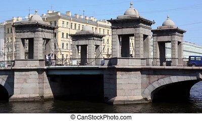 Traffic on Lomonosov bridge over river in Petersburg city