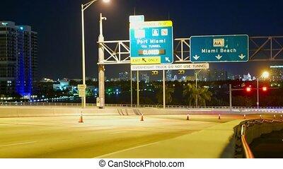 Traffic on Mc Arthur Causeway Bridge to Miami Beach at night - time lapse shot at night - MIAMI, FLORIDA - APRIL 10, 2016