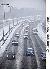 Traffic On Motorway During Snowstorm