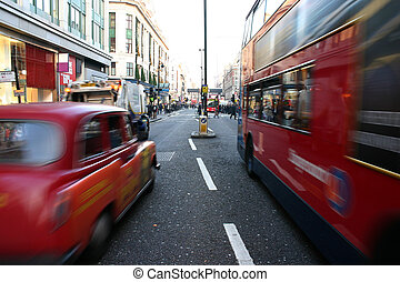 Traffic on Oxford Street in London - Black cab and coach ...