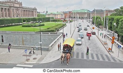 Traffic on street above museum of medieval Stockholm which...