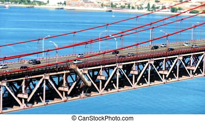 Traffic on the 25 de Abril Bridge in Lisbon Portugal -...
