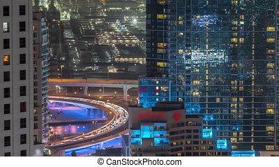 Traffic on the bridge at JBR and Dubai marina aerial night timelapse.
