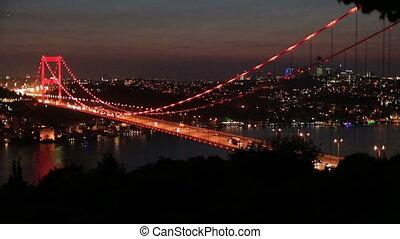 traffic on the bridge at night