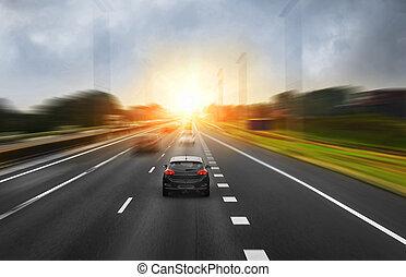 Traffic on the high way. - Traffic on the high way at sunset...