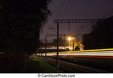 traffic on the railroad tracks at night