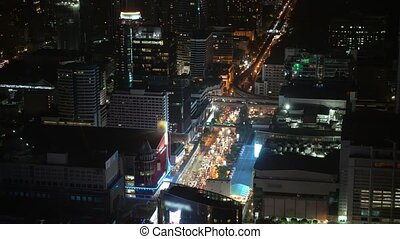 traffic on the streets of the business center of a big city at night