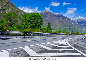 Traffic on Toll Road in the Italian Alps