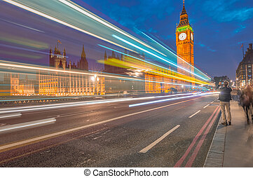 Traffic on Westminster Bridge with car light trails.
