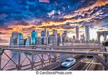 Traffic over Brooklyn Bridge at sunset