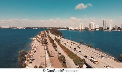 Traffic over Rickenbacker Causeway in Miami, slow motion aerial view.