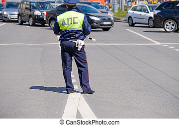 Traffic policeman works on the street at day time