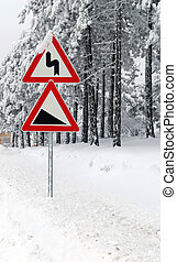 Traffic road sign in snow