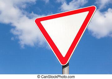 Traffic sign against blue sky background