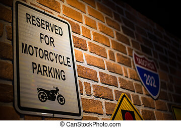 traffic sign on the wall of motorcycle shop.