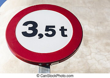 Traffic sign outdoors prohibiting throroughfare of vehicles with a weight over 3,5