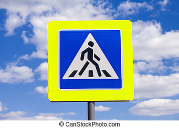 Traffic sign pedestrian crossing with clouds in background