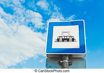 Traffic sign. Tram station sign on a street in the city against a blue sky