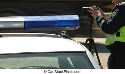 Traffic speed enforcement - Police officer checking vehicle...