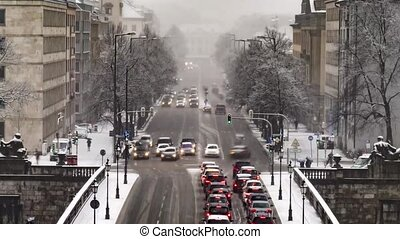 Traffic time lapse during a snow storm in Munich, Germany -...