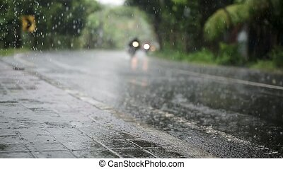 Traffic under rain - Sopping roadway with a traffic under...