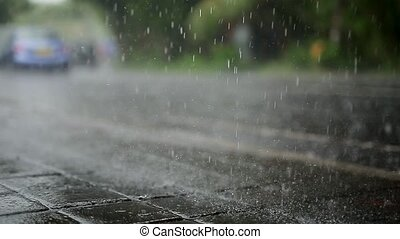 Traffic under rain - Wet roadway with a traffic under the...