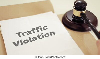 Traffic Violation written on legal documents with gavel -...