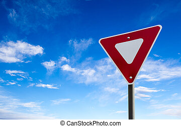 Traffic Yield Sign With Blue Sky Background
