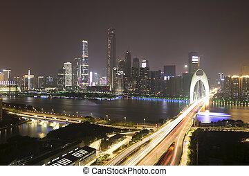 trafic, brouiller mouvement, sur, pont, à, nuit, cityscape, fond