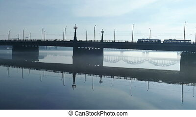 Trafic on Stone Bridge near Riga Old Town seen over foggy...