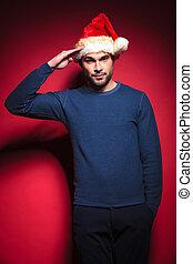 tragen, blaues, pullover, junger, santa, salutieren