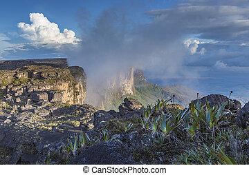 Trail down from the plateau Roraima passes under a falls - Venezuela, South America