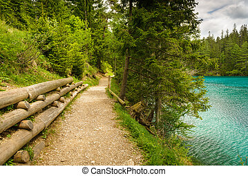 Gravel trail in mountains near turquoise lake-Gruener See, Styria, Austria.