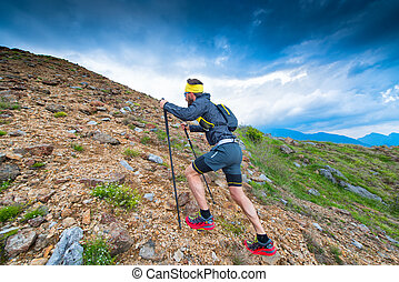 Trail in the mountains athlete during training