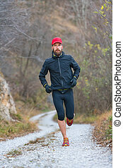Trail mountain athlete during training in dirt road