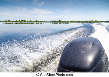 Trail of beautiful water from motor boat