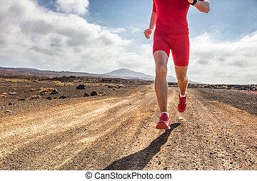 Trail runner athlete man running on dirt mountain path in ...