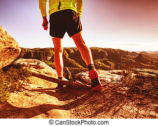 Trail runner athlete man. Slim person training in mountains