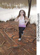 Trail runner dodging roots