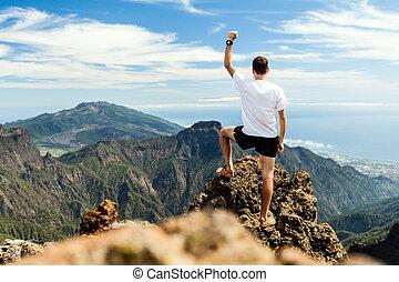 Trail runner success, man running in mountains