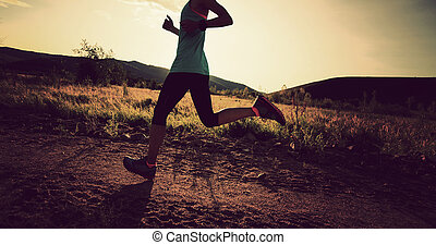 trail runner woman running on forest trail