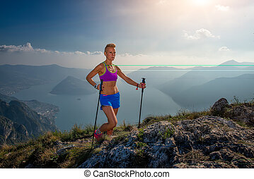 Trail running in the mountains girl athlete