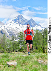 Trail running runner in the mountains