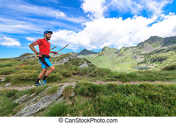 Trail running with poles in the mountains