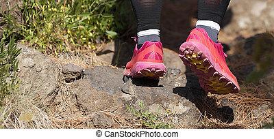 Trail running woman on mountain path