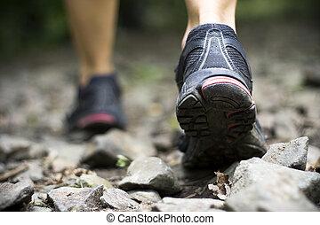 Trail walking in mountains - Sport shoes on trail walking in...