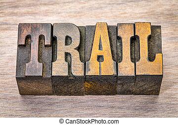 trail word in vintage wood type