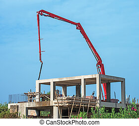 Trailer-mounted boom concrete pump at construction site.