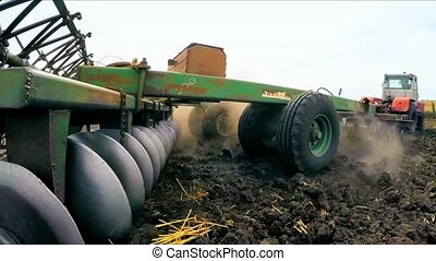 Trailer Of Tractor Plowing Soil In The Field - CLOSE UP,...